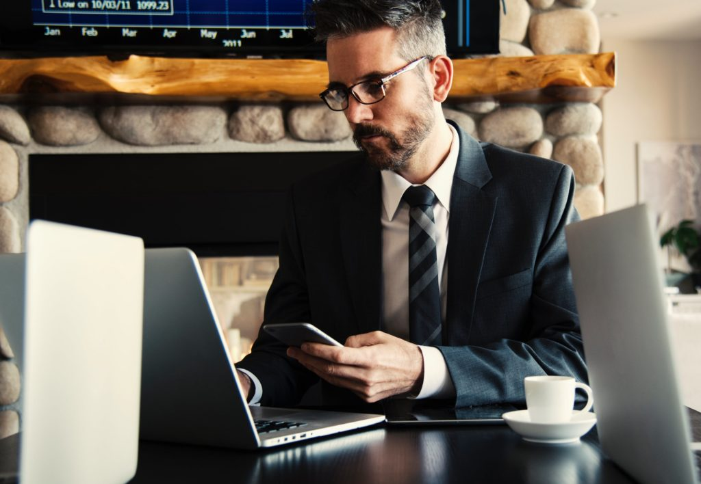 lawyer-using-computer and phone